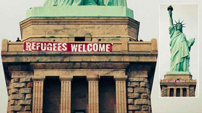 """自由女神像悬挂""""欢迎难民""""横幅引热议(双语)"""